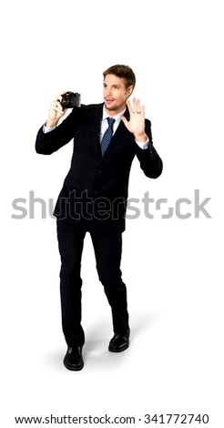 Friendly Caucasian man with short medium blond hair in business formal outfit using camera - Isolated - stock photo