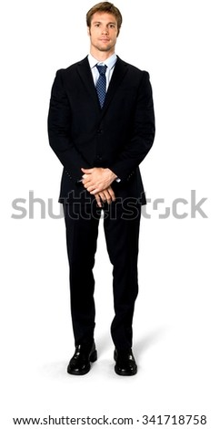 Friendly Caucasian man with short medium blond hair in business formal outfit with hands covering crotch - Isolated