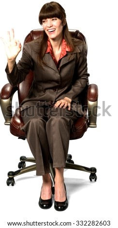 Friendly Caucasian woman with long dark brown hair in business formal outfit with hands on thighs - Isolated