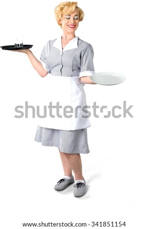 Friendly Caucasian woman with short light blond hair in uniform holding tray - Isolated