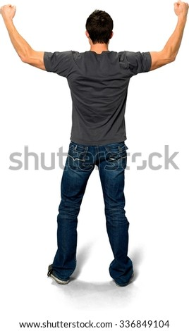 Friendly Caucasian young man with short black hair in casual outfit with arms open - Isolated - stock photo