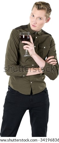 Friendly Caucasian young man with short light blond hair in casual outfit holding wine glass - Isolated