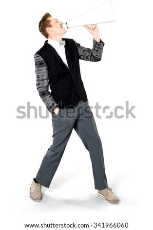 Friendly Caucasian young man with short light blond hair in evening outfit using megaphone - Isolated