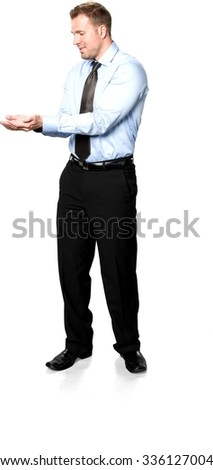 Friendly Caucasian young man with short medium brown hair in business formal outfit holding invisible object - Isolated