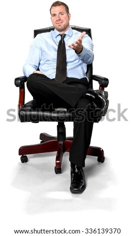 Friendly Caucasian young man with short medium brown hair in business formal outfit pointing using palm - Isolated