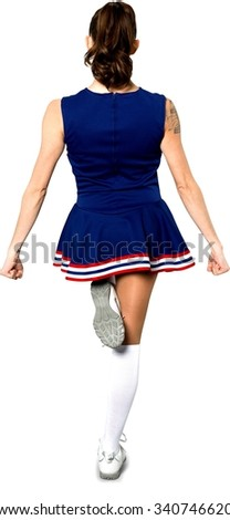 Friendly Caucasian young woman dark brown in uniform cheerleading - Isolated - stock photo