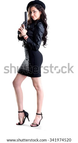 Friendly Caucasian young woman with long dark brown hair in casual outfit holding handgun - Isolated - stock photo