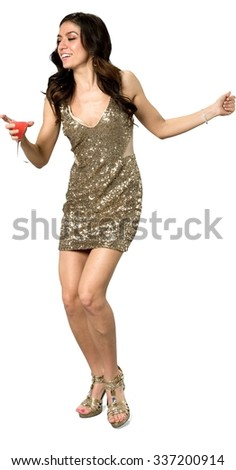 Friendly Caucasian young woman with long dark brown hair in evening outfit holding martini glass - Isolated - stock photo