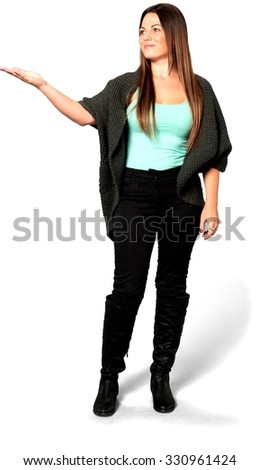 Friendly Caucasian young woman with long medium brown hair in casual outfit pointing using palm - Isolated