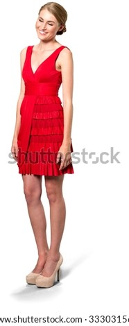 Friendly Caucasian young woman with medium blond hair in evening outfit - Isolated