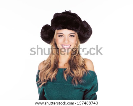 Friendly charming blond woman in a trendy black hat looking at the camera with a beautiful smile, isolated on white - stock photo