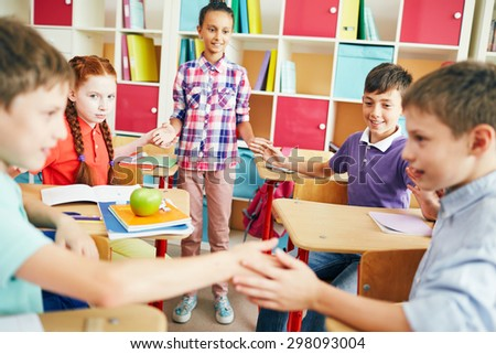 Friendly classmates playing at break between lessons - stock photo