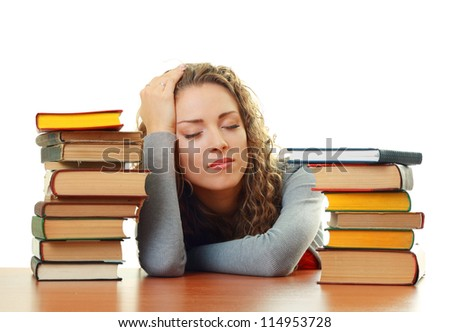 Friendly College student girl sleeping  near books at the desk isolated