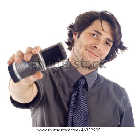 Friendly confident business man holding a mobile phone, isolated over a white background - stock photo