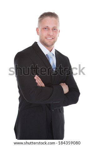 Friendly confident stylish young businessman standing smiling at the camera  full length isolated on white