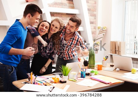 Friendly creative team is expressing positive emotions - stock photo