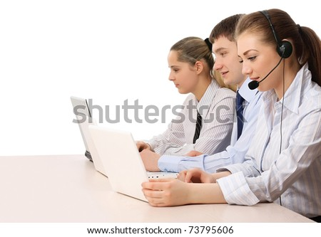 Friendly customer service consultants working, focus on a young man