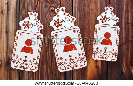friendly 3d rendered christmas labels with man sticker in front of a nice wooden background