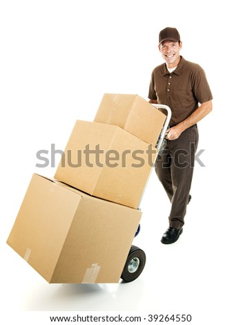 Friendly delivery man or mover pushes a stack of boxes on a hand truck.  Full body isolated. - stock photo