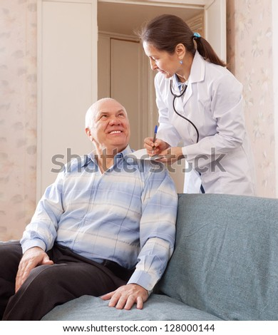 friendly doctor asks joyful mature patient feels - stock photo