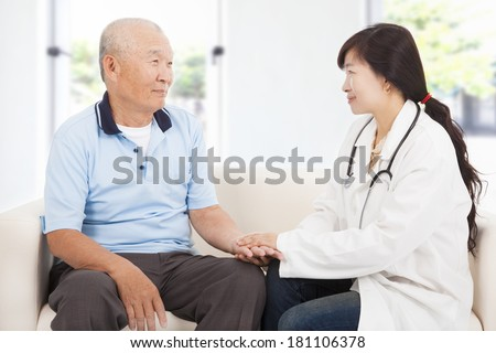 friendly doctor caring senior man indoor room - stock photo