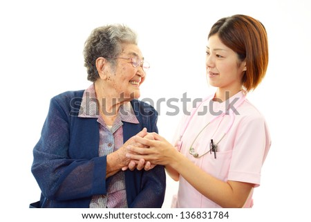 Friendly doctor with elderly woman