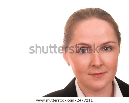 Friendly face of young woman with formal hairdo with a copyspace at the side - stock photo