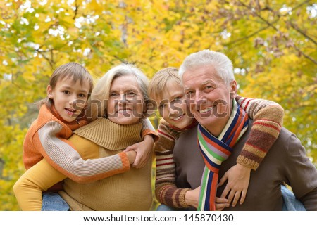 friendly family walking in the park in autumn - stock photo