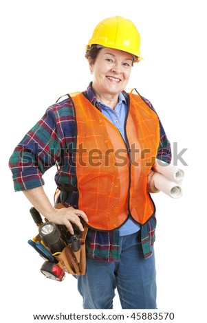 Friendly female construction contractor with her tools and blueprints.  Isolated on white. - stock photo