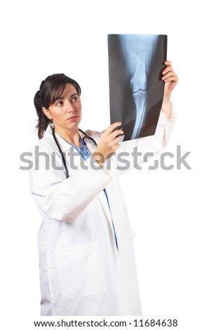 Friendly female doctor in lab coat , examining x-ray against white background