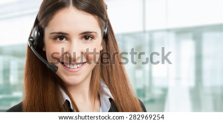 Friendly female phone operator portrait - stock photo