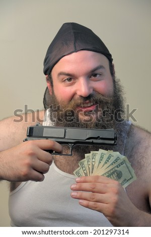 Friendly gangster with money and gun - stock photo