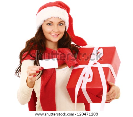 Friendly girl in santa hat with xmas gift showing blank business card isolated on white background - stock photo