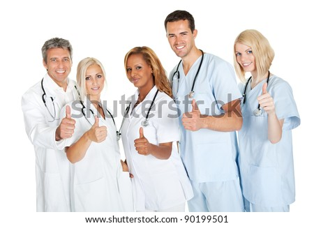 Friendly group of doctors with thumbs up isolated over white background - stock photo