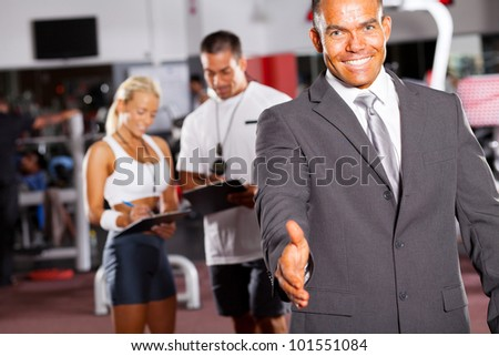 friendly gym manager hand shake gesture - stock photo