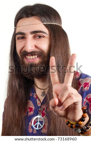 Friendly hippie with long hair making peace sign - stock photo