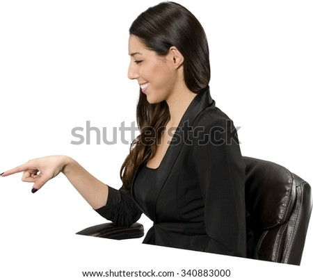Friendly Hispanic young woman with long dark brown hair in casual outfit pointing using finger - Isolated