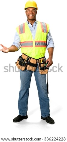 Friendly Male Construction Worker with short black hair in uniform holding screwdriver - Isolated - stock photo
