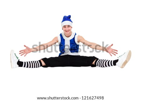 friendly man dressed like a funny gnome makes splits on an isolated white background - stock photo