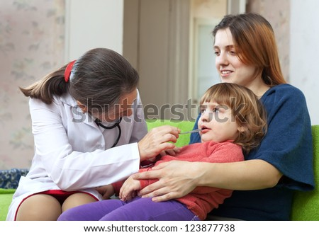 friendly mature children's doctor examining 2 years baby