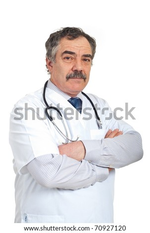 Friendly mature doctor man standing with arms folded isolated on white background