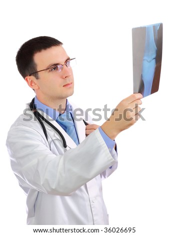 Friendly medical doctor  looking  on  x-ray image . Isolated - stock photo