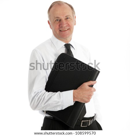 Friendly middle-aged business executive Friendly middle-aged business executive in his shirtsleeves smiling at the camera with a leather portfolio under his arm