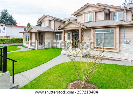 Friendly neighborhood of modern houses in Vancouver, Canada. - stock photo