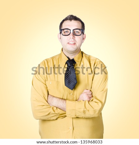 Friendly nerd business sales man with arms folded on yellow background. Trustworthy concept