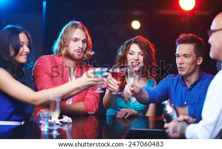 Friendly people toasting at party