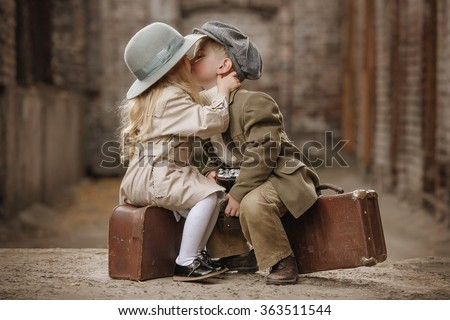 Friendly romantic encounter boys and girls autumn day in the old town - stock photo