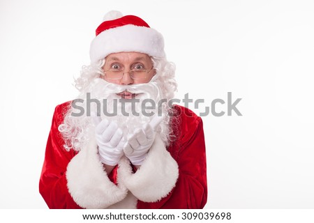 Friendly Santa Claus is sending air kiss to people. He is smiling happily and looking forward with joy. Isolated on background and copy space in right side - stock photo