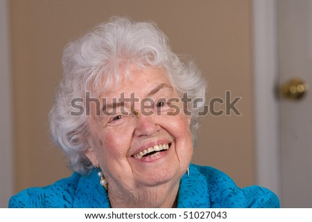 Friendly senior citizen woman with a big smile.