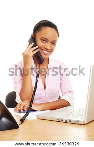 friendly smiley woman talking on the phone at the workplace